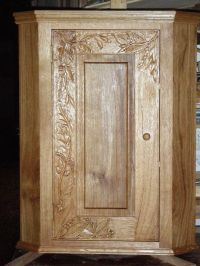 Carved oak corner cupboard