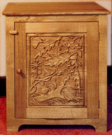 Carved oak cupboard- dunnock and wren