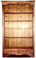 Elm bookcase with ivy carved on drawers